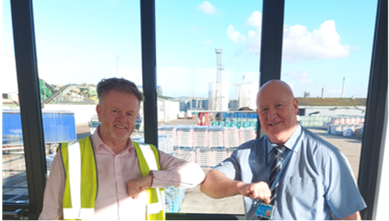 Photograph of Iain Brown with Alec Johns, Select Security Operations Director.